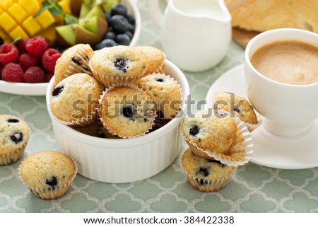 Fresh and bright continental breakfast table with blueberry muffins - stock photo