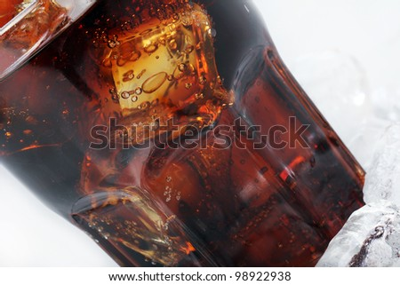 Fresh and cold cola drink in glass - stock photo