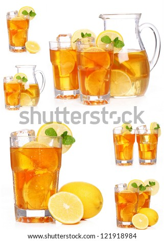 Fresh and cold ice tea with sliced lemon and mint - stock photo