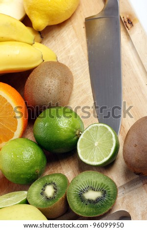 Fresh and colorful fruits on wooden board
