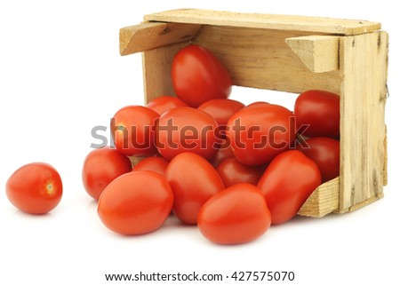 fresh and colorful italian roma tomatoes in a wooden crate on a white background - stock photo