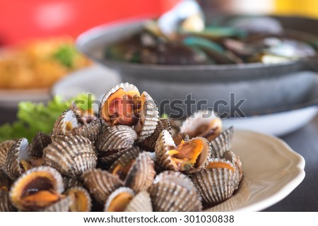 Fresh and delicious cockles and mussels for seafood background  - stock photo