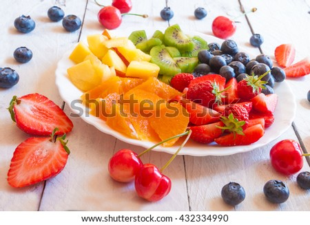 Fresh and delicious fruit salad of rainbow colors - stock photo