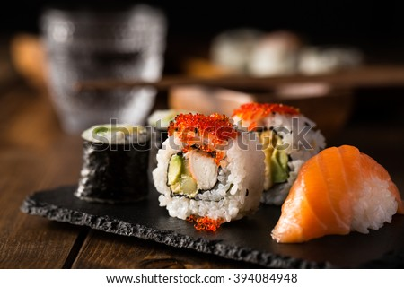 Fresh and delicious maki and nigiri sushi and sake glass. - stock photo