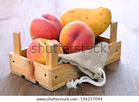 fresh and delicious peach and mango in crate