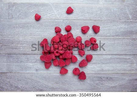 fresh and delicious raspberries on wooden background