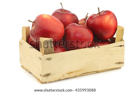 Fresh and delicious red Jonagold apples in a wooden crate  on a white background