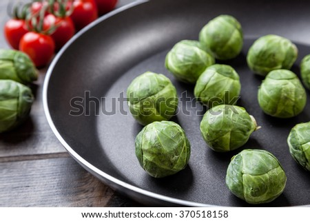 Fresh and healthy organic brussels sprouts in a frying pan - stock photo