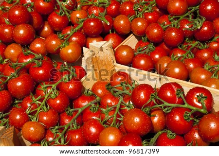 Fresh and healthy red tomatoes in a wooden box