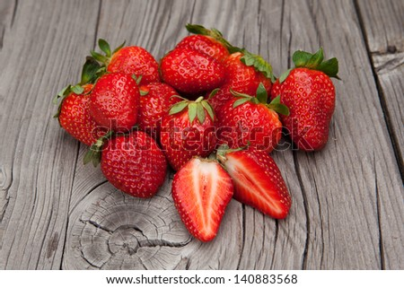 Fresh and juicy strawberries on a old wooden background - stock photo