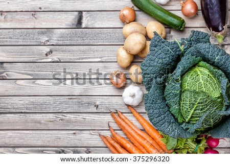 Fresh and organic bio vegetables on a wooden background - stock photo