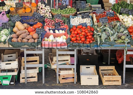 Fresh and organic vegetables at farmers market stall - stock photo
