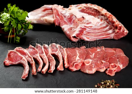 Fresh and raw meat. Ribs and pork chops uncooked, ready to grill and barbecue - stock photo
