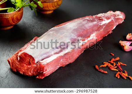 Fresh and raw meat. whole piece of Sirloin  steaks in a row ready to cook. Background black blackboard - stock photo