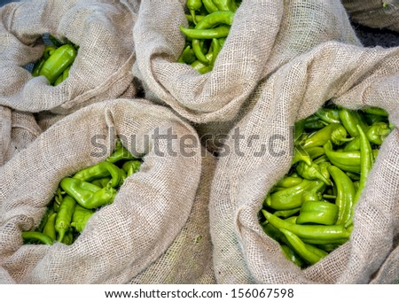 Fresh and ripe peppers ready for eating in brown bags - stock photo