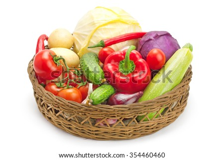 fresh and ripe vegetables arranged in a basket isolated on white - stock photo