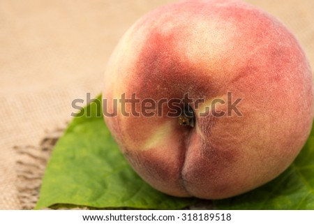 Fresh and ripe whole peach with green leaf for fruit background