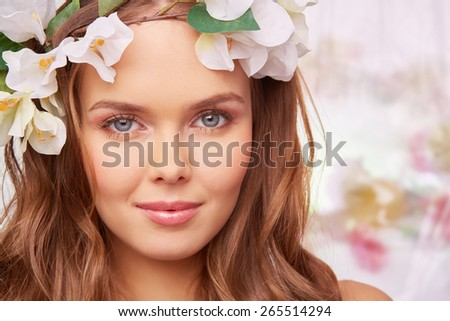 Fresh and sensual woman in floral wreath - stock photo
