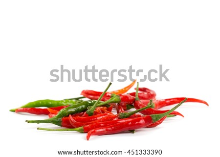 Fresh and spicy red chili peppers on white background. - stock photo