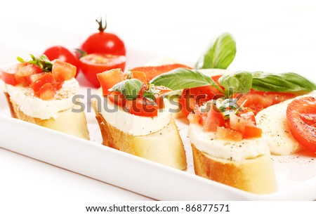 Fresh and tasty bruschetta over white background