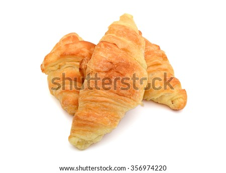 Fresh and tasty croissant on the white background - stock photo