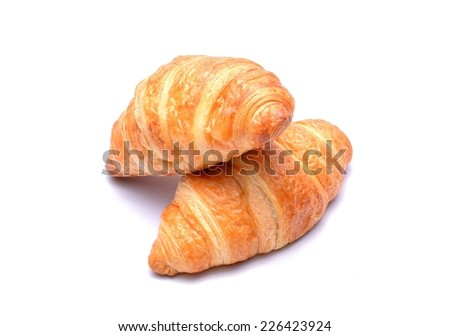 Fresh and tasty croissants isolated on  white background - stock photo
