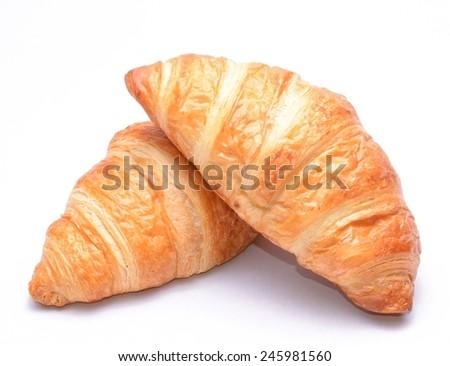 Fresh and tasty croissants on white background - stock photo