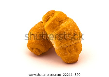 Fresh and tasty croissants over white background - stock photo