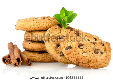 Fresh and tasty oat biscuits with cinnamon sticks on white background. - stock photo