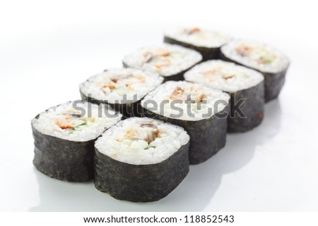 fresh and tasty sushi on white reflective background