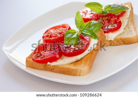 Fresh and tasty toast bread with mozzarella tomatoes and basil leaves - stock photo