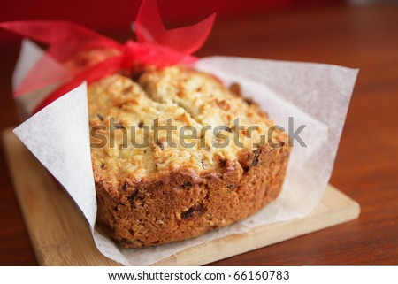 Fresh and warm banana bread with paper and red ribbon - stock photo