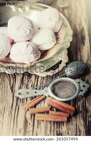 fresh appetizing and tasty zephyr on the table /delicious dessert in vintage style - stock photo