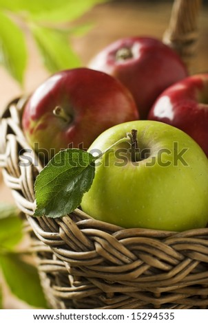 fresh apple fruit in a basket close up - stock photo