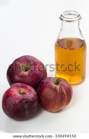 Fresh apple juice and apples isolated on white.