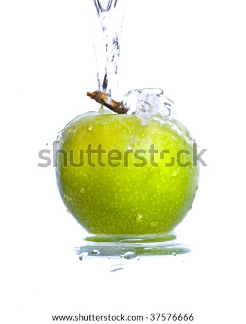 Fresh apple jumping into water with a splash