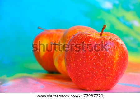 Fresh apple with a colorful background - stock photo