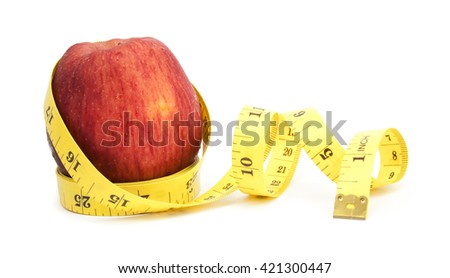 fresh apple with measuring tape isolated over white background