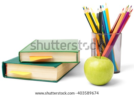Fresh apple with pile of books