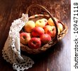 Fresh apples in a wattled basket - stock photo