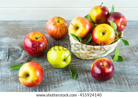Fresh apples in the  basket on the rustic background. Ripe  fruits as vegetarian food concept. Healthy eating concept with fresh fruits. - stock photo