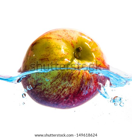 Fresh apples to eat and water splash isolated on white background. - stock photo
