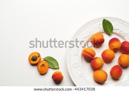 Fresh apricot fruits on white background close up - stock photo