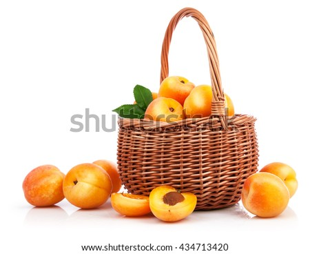 Fresh apricot with green leaf in wicker basket still life of fruits isolated on white background and copyspace - stock photo