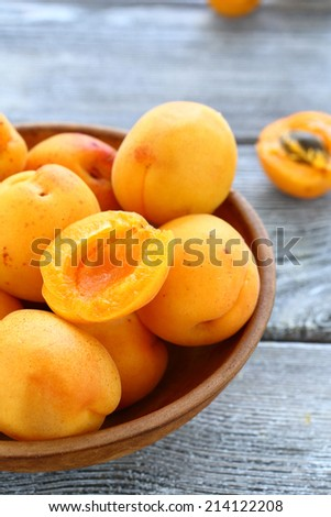 Fresh apricots in bowl, fruits - stock photo