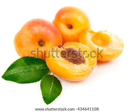 Fresh apricots in section with green leaves still life of ripe fruits isolated white background - stock photo