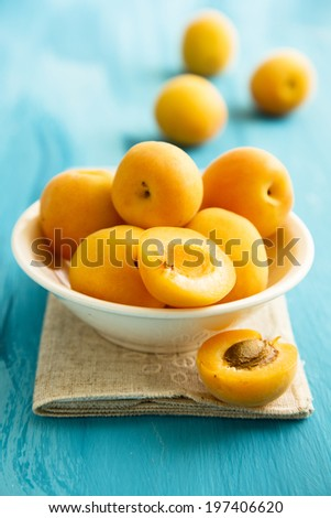 Fresh apricots in white bowl