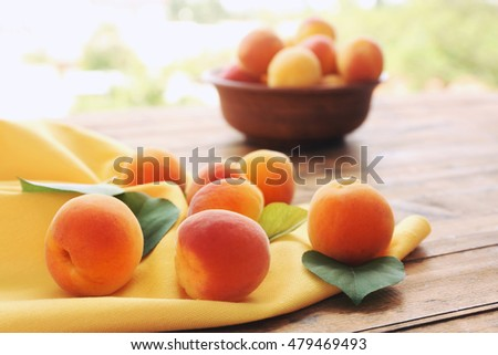 Fresh apricots on table