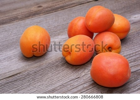 Fresh apricots on wooden background - stock photo