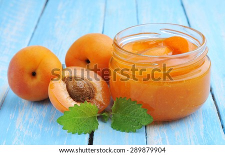Fresh apricots with green mint.